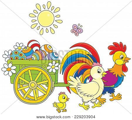 Small Wooden Cart With Painted Easter Eggs Pulled By A Colorful Rooster With A Hen And A Little Chic