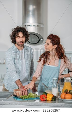 View Of Girlfriend Forbidding Boyfriend Take Uncooked Food