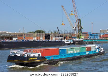 Antwerp, Belgium - Jul 9, 2013: Barge Ship Transporting Containers In The Port Of Antwerp.