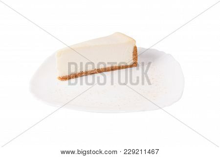 Classic Cheesecake On A White Plate Isolated On White