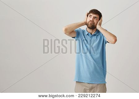 Hate My Loud Neighbors. Portrait Of Annoyed Angry Husband, Covering Ears With Hands And Looking Up W