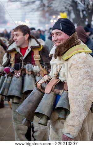 Pernik, Bulgaria - January 26, 2018: Male Dancer In Fur Costume Called Kuker Shows Off His Huge Bras