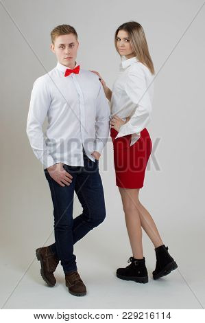 A Man Is A Sportsman And A Woman In A Red Skirt.guy With The Girl On A White Background