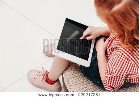 Cropped Shot Of Redhead Child Using Digital Tablet With Blank Screen Isolated On Grey