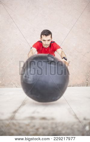 Man Training With The Medicine Ball Against The Wall Aerial Vision 02