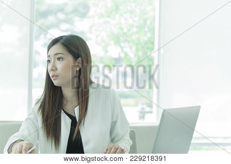 Woman Working With Intention And Seriously In The Office Interior.