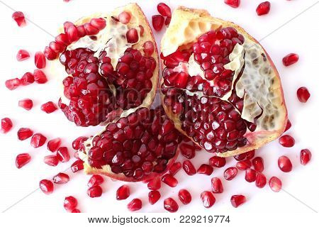 Pomegranate Seeds Isolated On White Background, View From Above. Vegetarian Concept, Organic Vitamin