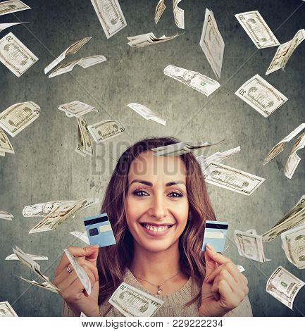 Happy Debt Free Woman Holding A Credit Card Cut In Two Pieces Under Money Rain