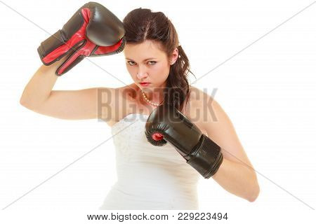 Violence In Relationship Concept. Dominant Bride Wearing Wedding Dress And Boxing Gloves