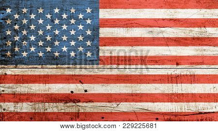 Old Grunge Vintage American Us National Flag Over Background Of White Painted Wooden Planks Board