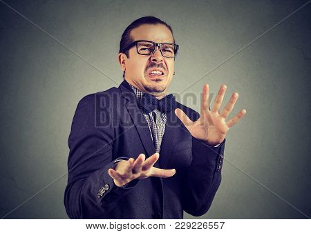 Elegant Man Doing Stop Gesture And Looking Away With Disgust And Fear.