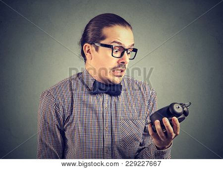 Young Formal Man Holding Alarm Clock And Looking Extremely Stressed With Being Late.