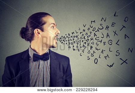 Man Talking With Alphabet Letters Coming Out Of His Mouth. Communication, Information, Intelligence