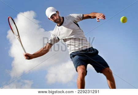 male tennis player in action, motion blurs