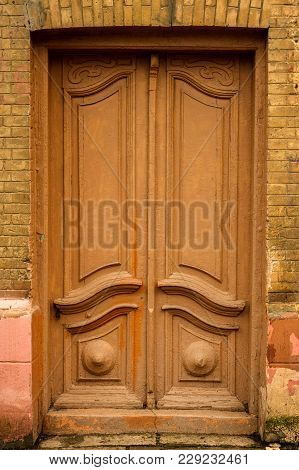 Wooden Ancient Italian Door In The Historic Center. Old European Architecture. Two-fold Wooden Carve