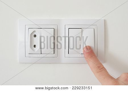 Turn Off Light Switch Close Up. Electric Socket With Power Plug