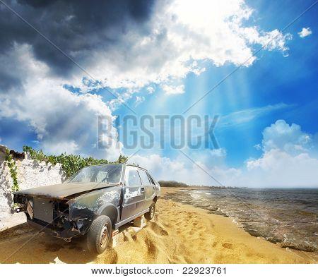 An old broken car on the beach