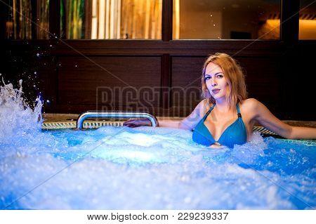 Beautiful Woman Sits In Whirlpool Tube