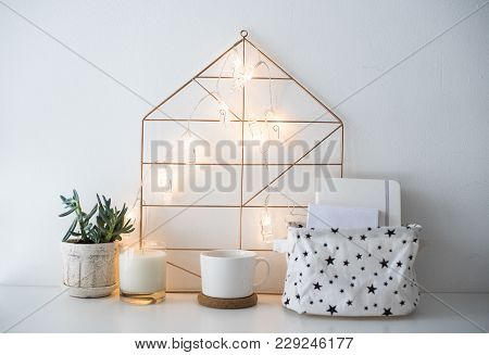 Minimalist Scandinavian Home Decor, Storage Box And String Lights In White Room Interior