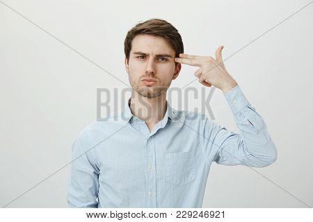 I Am So Miserable And Bored. Portrait Of Attractive Caucasian Office Worker Mimicking Handgun, Showi