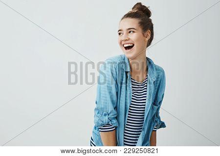 Hilarioous Friends Brighten Life. Studio Shot Of Positive Emotive Cute Girlfriend With Bun Hairstyle