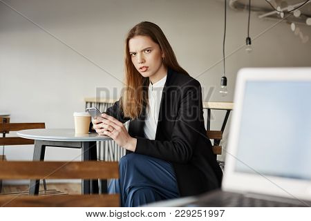 Woman Is Insulter With Offensive Words Of Stranger Sitting With Laptop. Portrait Of Annoyed Attracti