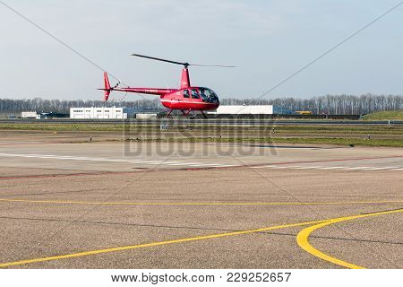 Lelystad, The Netherlands - February 02, 2018: Student With Teacher Practising Flying A Helicopter A