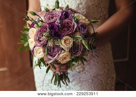 Young Beautiful Bride In White Dress Holding Wedding Bouquet, Bouquet Of Bride From Rose Cream Spray