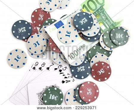 Casino Chips And Cards, And A Hundred Euros On A White Background .