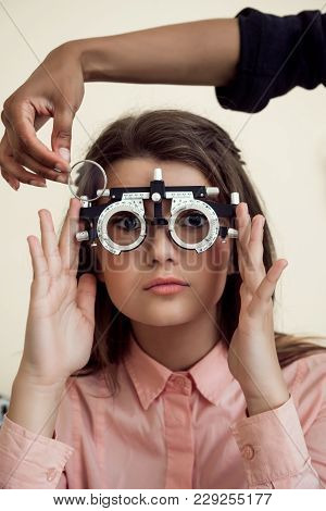Horizontal Shot Of Interested And Curious Caucasian Girl On Appointment With Eye Care Specialist Wea