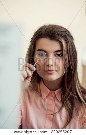 Horizontal Portrait Of Good-looking Focused Woman On Appointment With Ophthalmologist Holding Lense