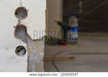 Holes For Electric Sockets On The Wall During Renovation Works