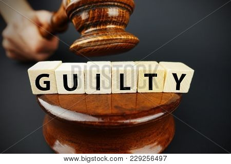 Guilty Court Decision With Judge Gavel And Wooden Cubes With Text