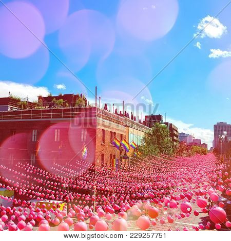 Summer Party Street In Gay Neighborhood Decorated With Pink Balls, With Bokeh Light Effect. Annual I
