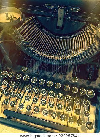 Keys Of A Vintage Typewriter. Retro Style Photo With Light Leaks.