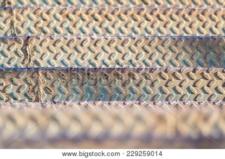 Metal Ladder As Background . Photo Of An Abstract Texture