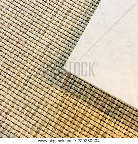 Corner Of A Marble Table On Carpet Floor. Contemporary Design.