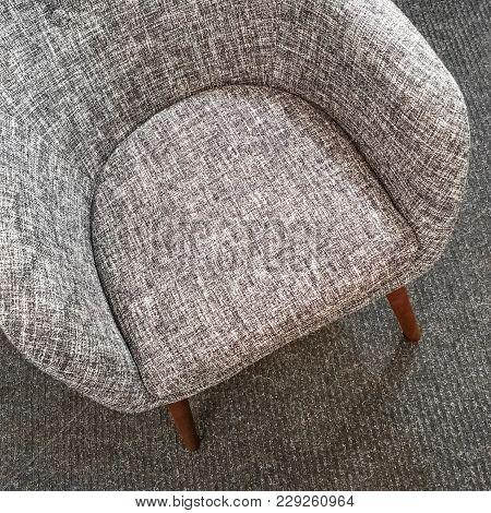 Stylish Gray Armchair On Carpet Floor. Comfortable Furniture.