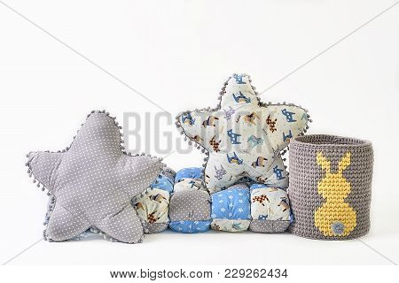 Two Five-pointed Star Shaped Pillows, Patchwork Comforter And Knitted Padded Stool On White Backgrou