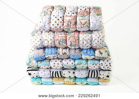 Patchwork And Fashion Concept - Beautiful Stack Of Colorful Quilts, Bedspreads Stacked In Several Ro