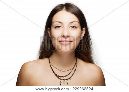Happy Brunette Girl Wearing A Necklace With Generic Symbols