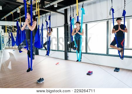 Students Standing Doing Anti-gravity Yoga
