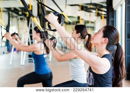 Beautiful Asian Girl Learning Using Total Body Resistance Exercise Trx For Training Her Slim Body Pu
