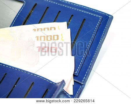 Putting A Lot Of Money Into A New Wallet. It Is Believed That There Will Be Plenty Of Money