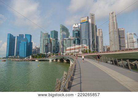 Singapore City, Singapore - 07 19 2015: Singapore Business District Skyscrapers And Marina Bay At Day.