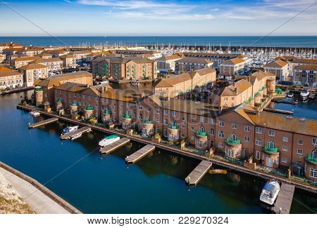 BRIGHTON, UK - JUN 5, 2013: Aerial view of artificial Brighton Marina, a popular housing and leisure complex with yachting marina
