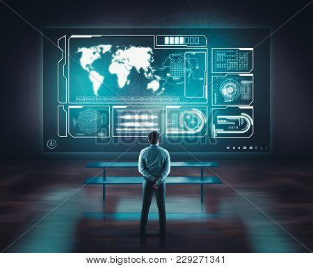 Businessman Working Of A Wall With A Toch Screen And Earth Globe. The Concept Of Working On A Networ