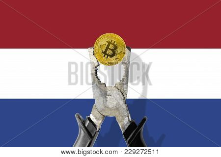 Bitcoin Coin Being Squeezed In Vice On The Netherlands Flag Background; Concept Of Cryptocurrency Bi
