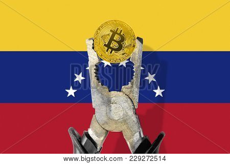 Bitcoin Coin Being Squeezed In Vice On The Venezuelan Flag Background; Concept Of Cryptocurrency Bit