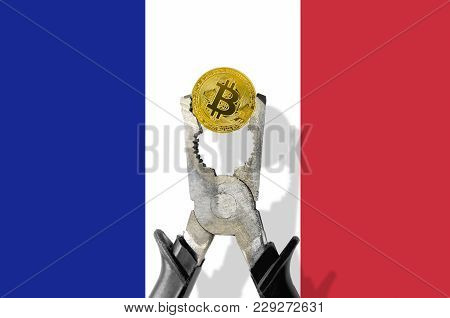 Bitcoin Coin Being Squeezed In Vice On The France Flag Background; Concept Of Cryptocurrency Bitcoin